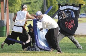 Battle games at Brookside: Clans of Aberdeen members fight like knights in days of old