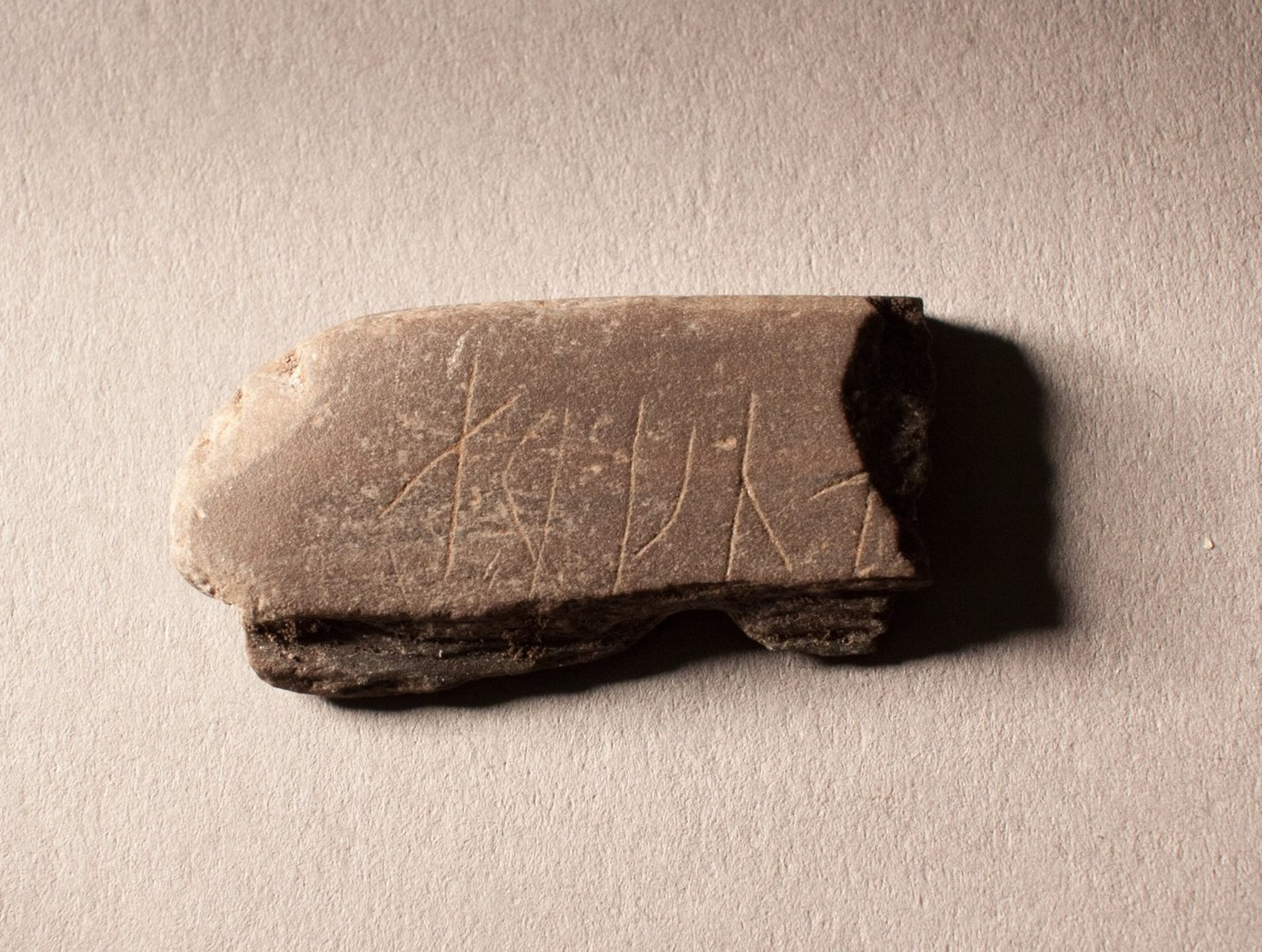 Viking era stone carved with runes found in norway