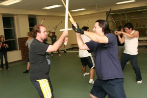 Students spar in new fencing club
