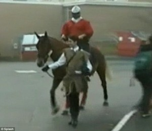 Teenager suspended from school for arriving dressed as a knight... and riding a HORSE